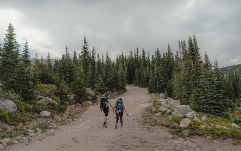 couple backpacking on their elopement day