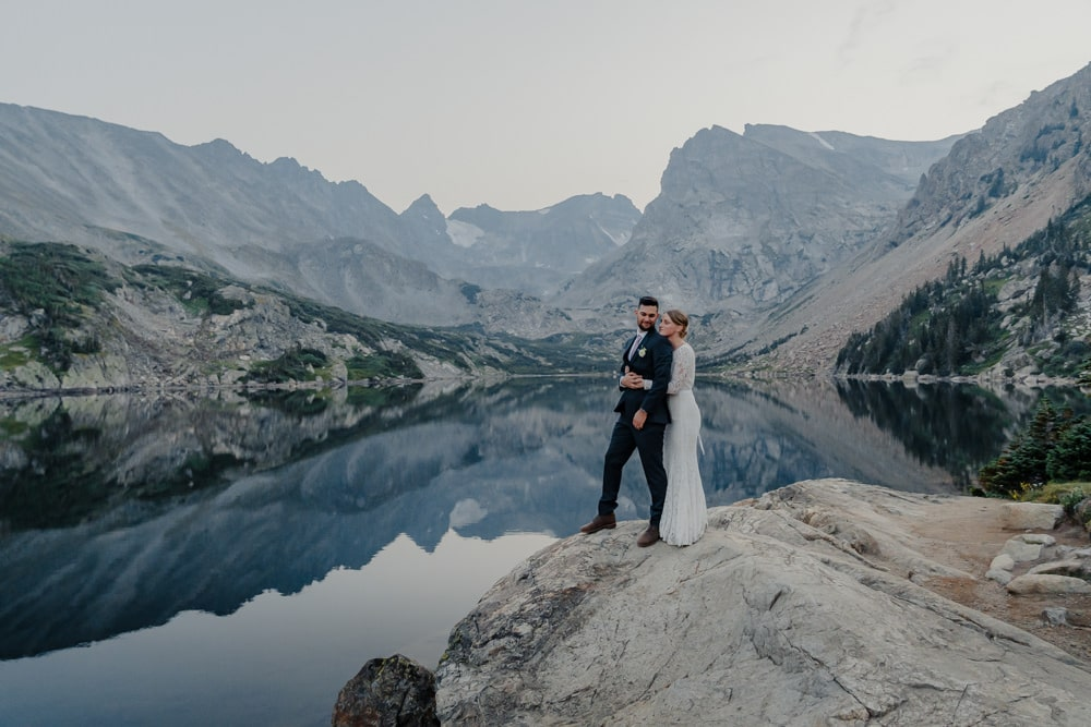 couple hugging at Lake Isabelle during their elopement