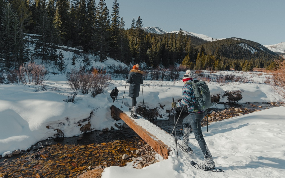 couple snowshoeing on their elopement day in Breckenridge