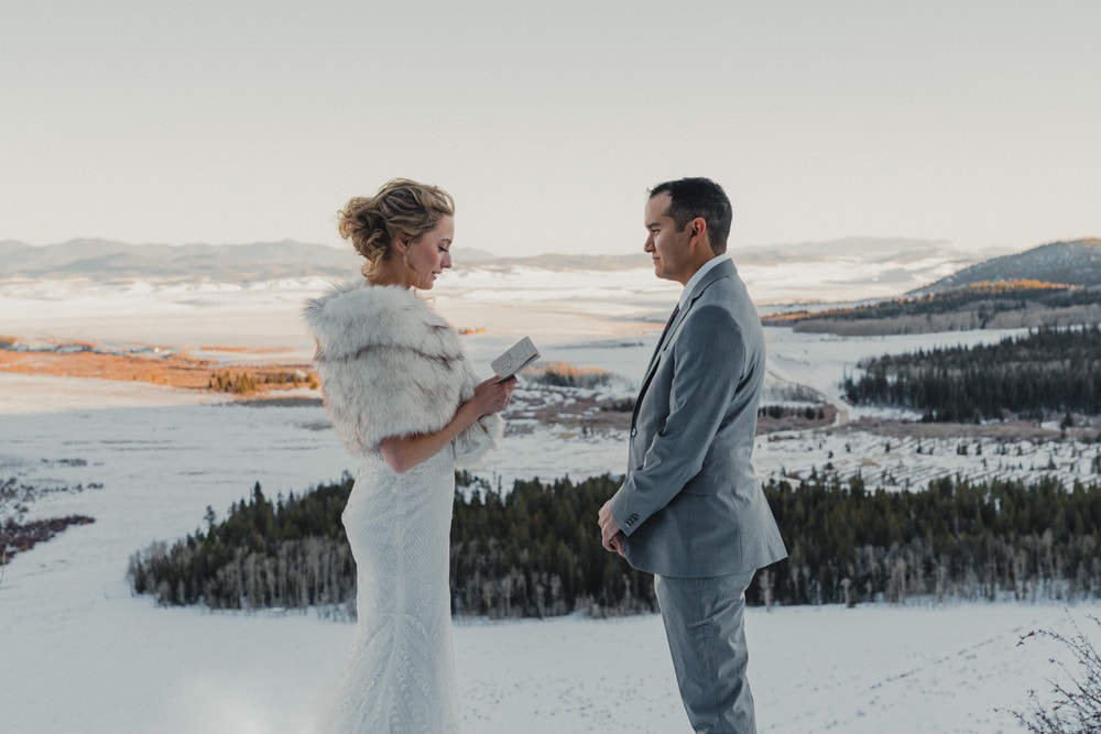 couple saying their vows during their winter elopement near breckenridge